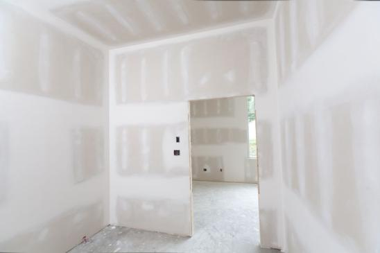 A room that has been drywalled and taped.