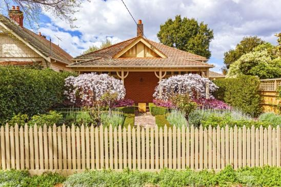 Charming 100 year-old Melbourne bungalow in leafy eastern suburbs with neat formal front garden picket fence