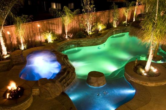 Swiming and spa lit with multi colored fiber optic lighting