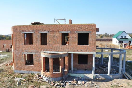 Built residential brick house. House Construction Site.