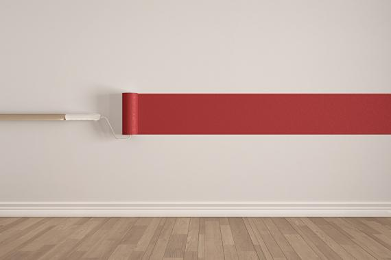 Empty room with paint roller and painted wall, wooden floor, white and red minimalist interior design