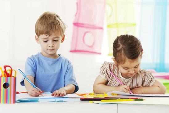 Little girl and little boy drawing; Shutterstock ID 157559861