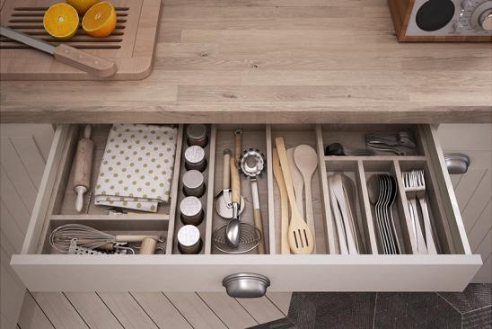 Kitchen tools in an open drawer