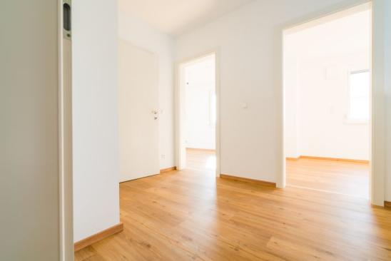 empty apartment with white walls and wooden floor for rent use it for real estate ads